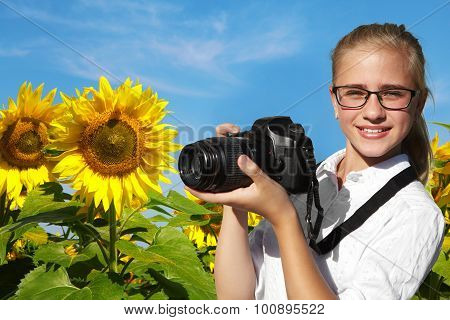 Young Photographer And Field Of Blooming Sunflowers