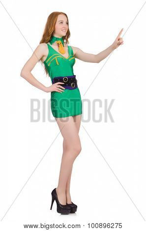 Young woman in green mini dress isolated on white