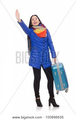 Pretty girl in blue winter jacket with suitcase isolated on white