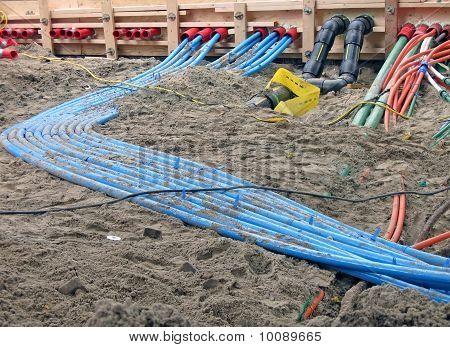 Color Cables Heap On Sand, Construction Site Diversity