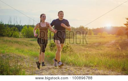 Young Couple Jogging Outdoors