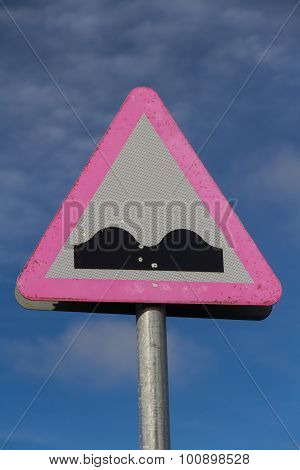 Road Warning Sign, Uneven Road.