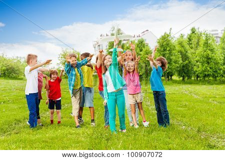 Happy kids reach after white airplane toy