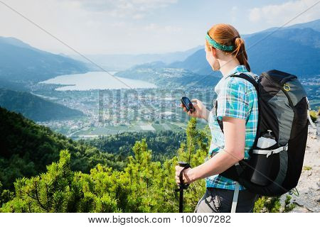 Hiker Navigating With A Gps Device