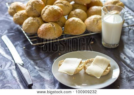 Baked Bread And Buns With Cheese And Glass Of Milk