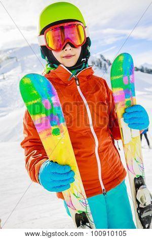 Ski, winter vacation, snow, skier, sun and fun - girl enjoying ski vacations