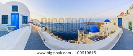 Santorini, Greece - Oia village at sunset, panorama