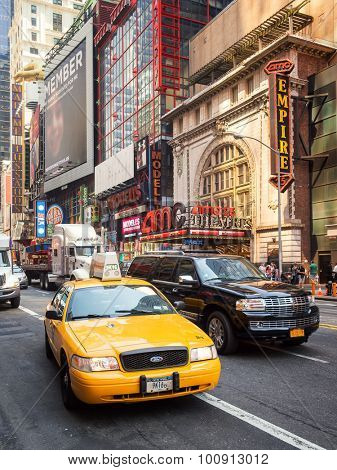 NEW YORK,USA- AUGUST 14,2015 : An iconic New York Yellow cab in the traffic of 42nd street in downtown Manhattan