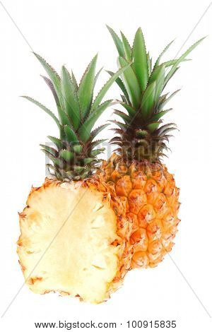 fruit diet - whole and half pineapples isolated over white background