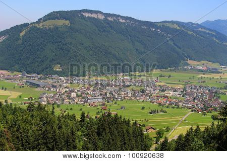 Scenic Alps Pastures, Town, Mountains
