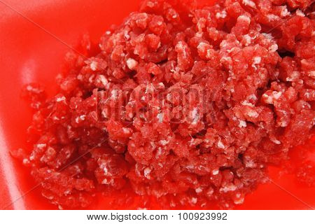 fresh raw mince beef meat on red tray isolated over white background