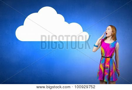 Young surprised romantic woman in multicolored dress