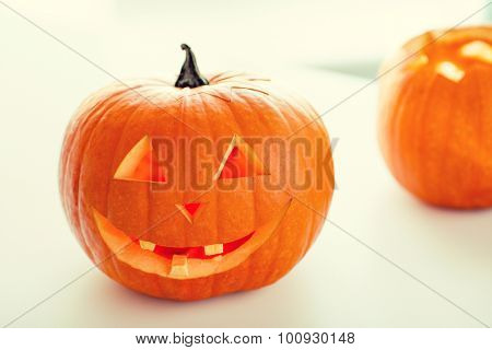 holidays, halloween and decoration concept - close up of pumpkins on table