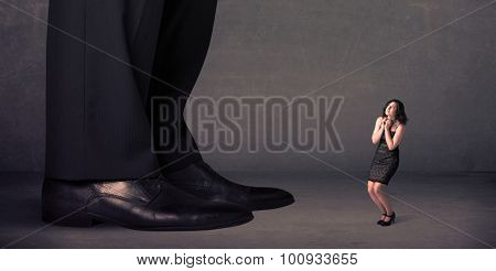 Huge legs with small businesswoman standing in front concept on background
