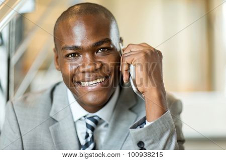 close up portrait of african male corporate worker talking on cell phone
