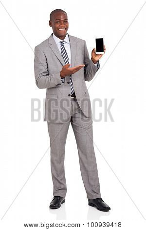 portrait of happy young african businessman presenting smart phone