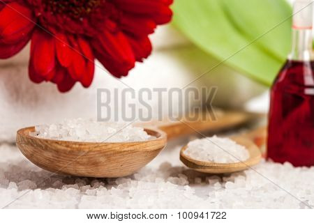 Spa essentials (bath salt in a spoon and flower)