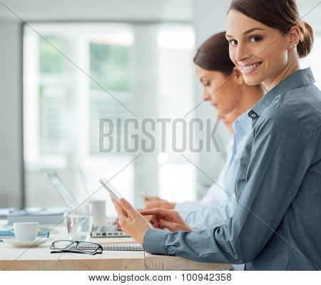 Business Woman Working At Office Desk With Her Colleagues