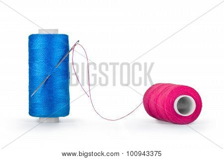 Needle And Spools Of Thread Isolated On White