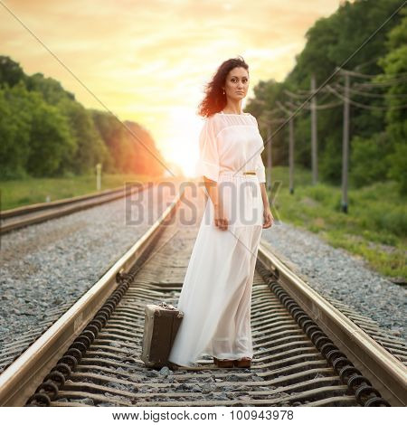 Young Alone Woman Standing With Suitcase On Railroad