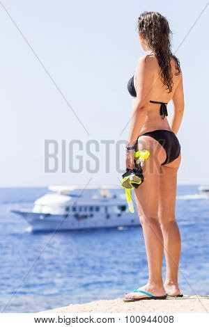 Young Woman In Bikini Holding Snorkeling Equipment