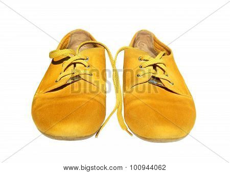 Pair of yellow shoes on white background
