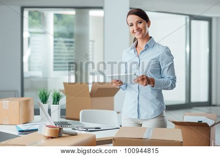 Business Woman In Her New Office Using A Tablet