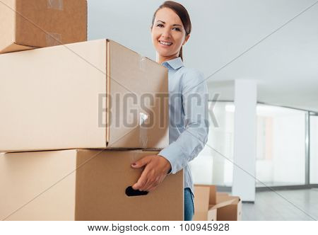 Young Woman Carrying Carton Boxes