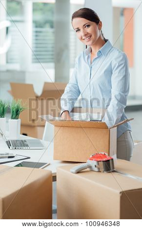 Business Woman Unpacking In Her New Office