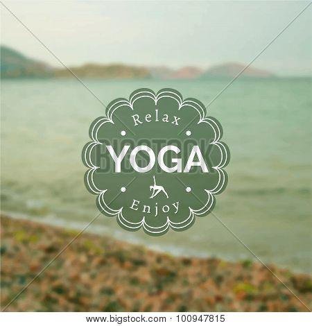 Name of yoga studio on a blurred photo background.