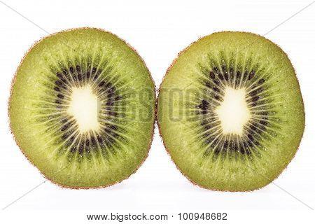 Two Slices Of Fresh Green Fruit Of Kiwi Isolated On White Background