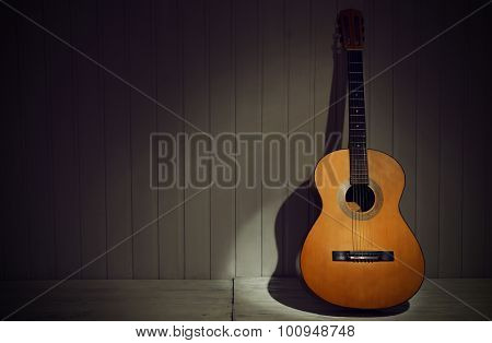 Classical guitar on wooden background