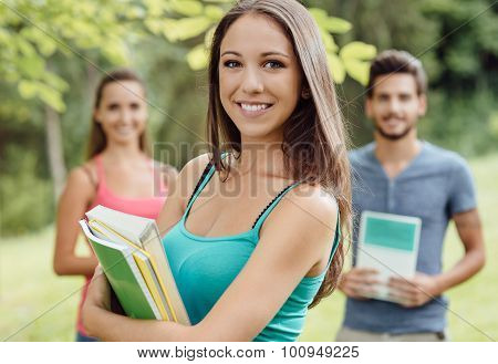 Smiling Student Posing With Notebooks