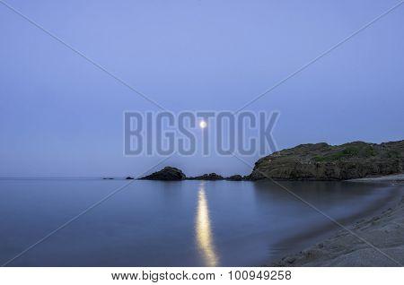 Full Moon And Moonbeam Between The Rocks On Cala Presili, Menorca, Spain.