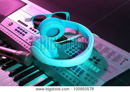 Headphones with microphone on synthesizer close up