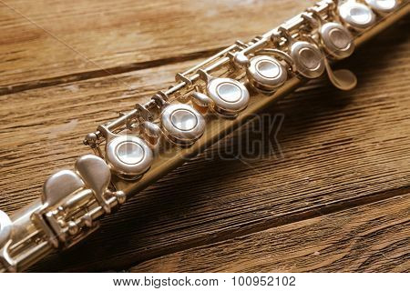 Flute on wooden background