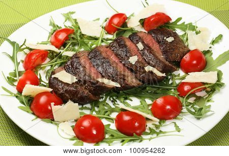 Juicy flank of steak sliced with vegetables