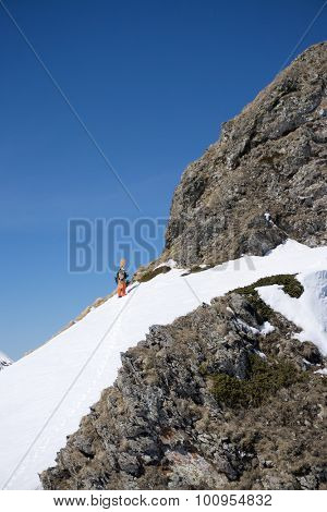 Snowboarder walking uphill for freeride, extreme sport