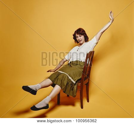 Expressive Woman Sits On The Chair And 70's Look Theme