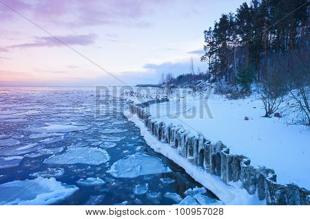 Winter Coastal Landscape With Frozen Pier