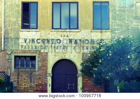 Old Entrance And Building. Glass Factory In Murano, Italy