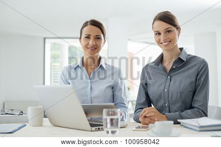 Business Women Working Together With A Tablet