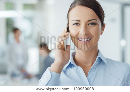 Smiling Business Woman On The Phone