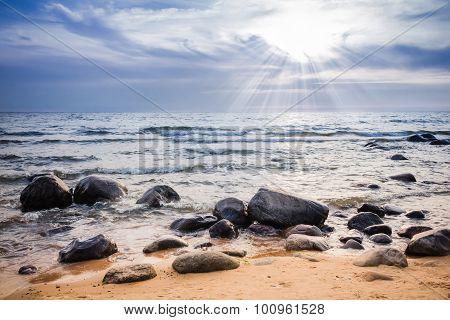 Sunset over rocky seacoast
