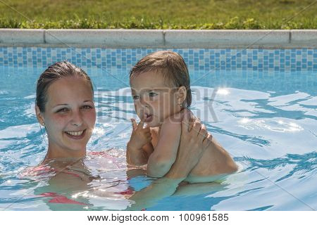 Mother with child enjoying a pool