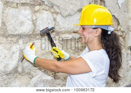 Woman With Hammer And Chisel In The Work