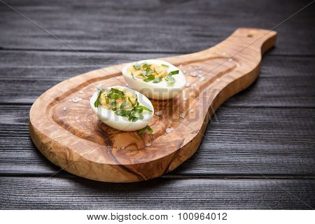 Boiled eggs on a cutting board.