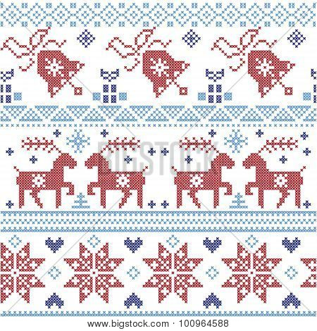 Dark and light blue and red  Scnadinavian Christmas  cross stitch pattern including reindeer, snowfl