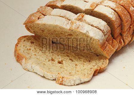 Fresh Sliced Bread On White Fabric Taken Closeup.