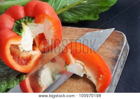 Knife Cutting Red Bell Pepper